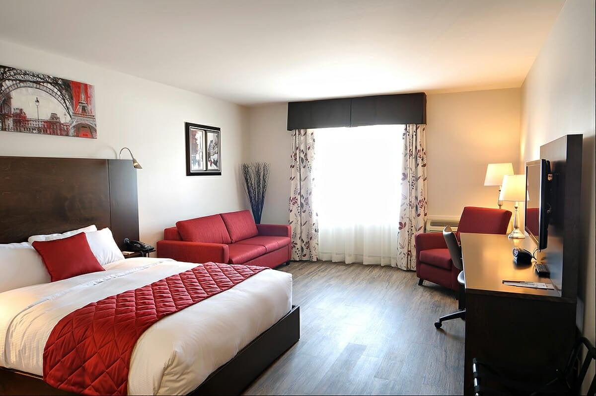 Chambre supérieure u2013 1 lit queen et 1 divan lit double hôtel le floral